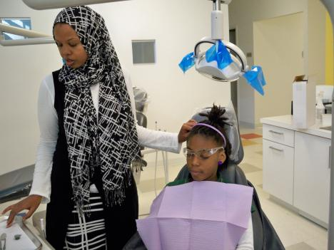 Knowledge Is Power charter school (KIPP DC) student Jailyn Herndon at the new Kids Smiles dental clinic in Southeast.