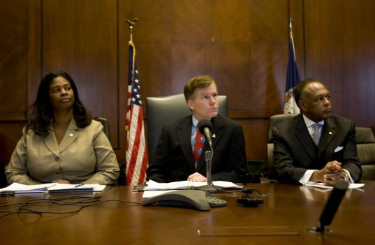 Gov. Bob McDonnell (center) sits with Secretary of Administration Lisa Hicks-Thomas (left) and Richmond Mayor Dwight C. Jones (right) on Wednesday as he announces a proposal to protect a historic Richmond site.
