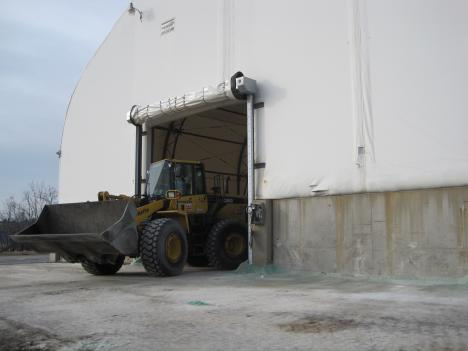A bulldozer moves salt from D.C.'s salt dome in Northeast Washington on Friday onto trucks, which then disperse it on streets throughout the city.