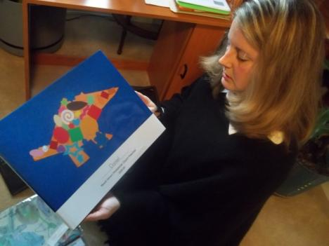 Kristin Matheis started a business printing children's artwork in hardcover books, which allows her to work from home.