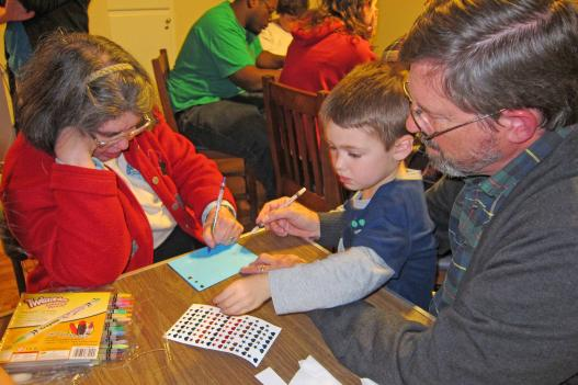 L'Arche community members Linda Garcia, Tristan Keener and John Cook make cards to send to friends in L'Arche communities around the world.