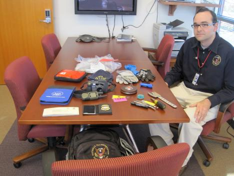 """Dennis Diaz carries a number of items with him in his """"Go Bag"""" in case of a plane crash."""