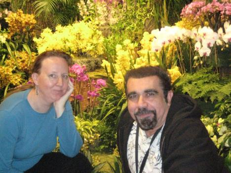 "Washington Gardener Magazine editor/publisher Kathy Jentz with the Smithsonian's Tom Mirenda, in front of orchids at ""Orchids: A View From the East."""