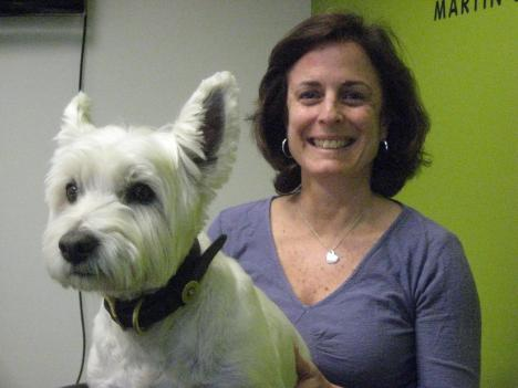 "GlobalGiving's Donna Callejon (pictured with resident ""underdog,"" Dixon) says in 2010, GlobalGiving disbursed $11 million to nearly 1,300 projects in approximately 100 countries."