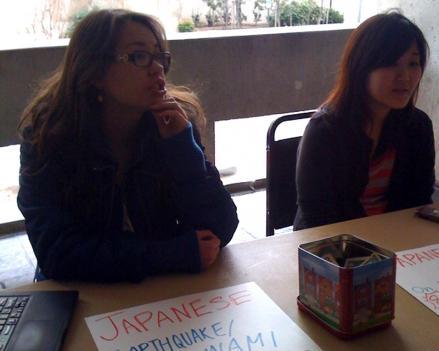 George Washington University students Emi Kamemoto (left) and Rumi Fujii (right) help with relief efforts.