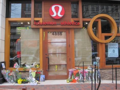 Lululemon on Bethesda Row was lined with flowers Monday. Two women, one dead and the other sexually assaulted, were found here Saturday morning.