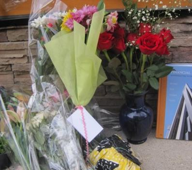 Mourners have left dozens of flowers outside Lululemon since the attack.