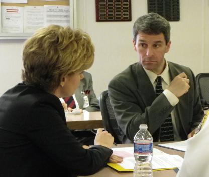 Virginia Attorney General Ken Cuccinelli, right, speaks with Liz Wixson, director of clinical and emergency services.
