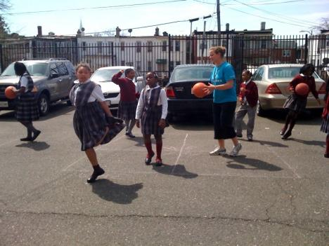 Playworks' Megan Cusick leads students in a series of games at Center City Public Charter School in Northeast D.C.