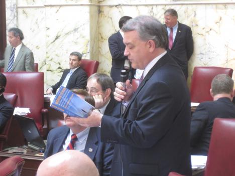 Republican Senator David Brinkley reads a book as he filibusters a bill that would allow illegal aliens to receive in-state tuition at state colleges.  While successful initially, the bill passed just before the Senate adjourned for the year.