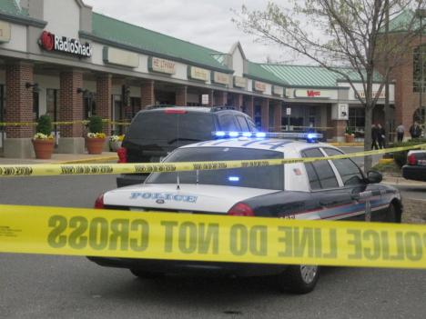 Fairfax County Police cordoned off nearly half the parking lot at Belle View Shopping Center in Alexandria for the entire afternoon as the search for the shooter continued.