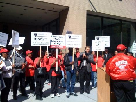 Members of the Washington Teachers' Union protest outside The Washington Post building in Northwest D.C.