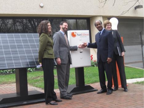 Montgomery County Executive Ike Leggett (second from right) and other officials unveil a new solar facility in Shady Grove, Md.