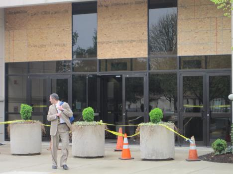 Plywood covers the damaged windows at Beth Sholom Congregation in Potomac, Md.