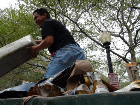 Workers dump wine and beer bottles from local restaurants ruined in the flood along the Georgetown waterfront.