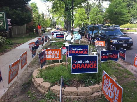 The scene outside one of the polling places in the District Tuesday, where, judging from the signs, the race was tight between sitting council member Sekou Biddle and Vincent Orange, both Democrats. Orange won the race, while Biddle came in third behind Republican Patrick Mara.