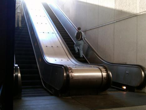 A woman fell through an open hatch near an escalator, like the one at the bottom of these Metro escalators, at the Pentagon Metro last week. The Metro employees that left the hatch open have since been fired.