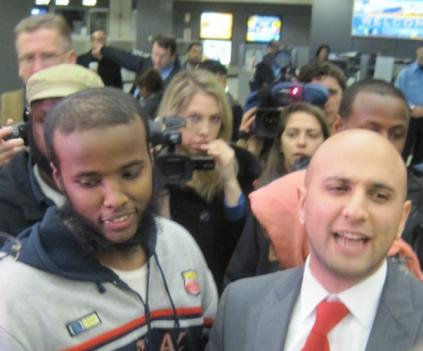 Gulet Mohamed (left) arrives at Dulles Airport from Kuwait on Jan. 21.