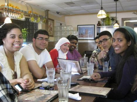 A group of students from Northern Virginia Community College -- many of them Muslims -- gather for lunch at Al Jazeera restaurant in Falls Church.