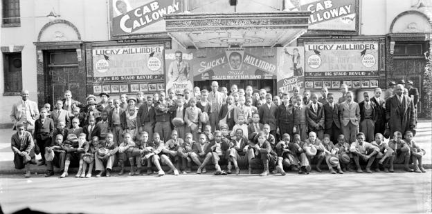 "Shaw was once D.C.'s ""Black Broadway."" Pictured here: newsboys and others in front of the Howard Theater, with Cab Calloway's name on signs, c. 1936"