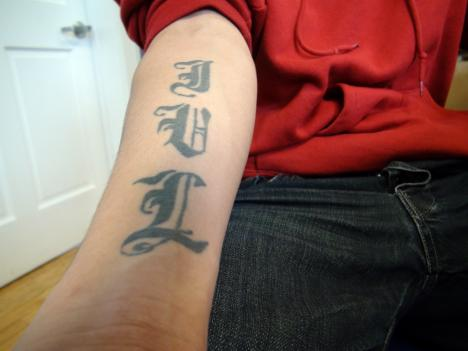 Police claimed the tattoo on his forearm was a gang symbol.