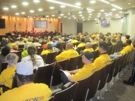 Union members, in yellow shirts, pack Montgomery County Council chambers ahead of a vote on union contracts.