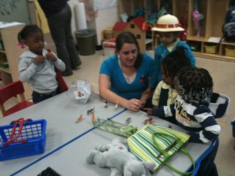 Students at Garfield Elementary gather around preschool/pre-kindergarten teacher Christine Rey.