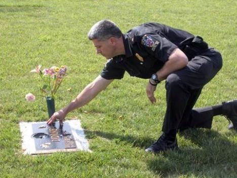 Montgomery County Police Captain Thomas Didone visits the grave of his son, Ryan, who died in a car accident when he was 15.