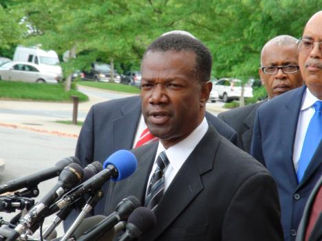 Former Prince George's County Executive Jack Johnson apologizes Tuesday after pleading guilty to two counts, surrounded by supporters and attorneys.