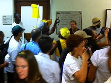 Dozens of homeless people and their advocates stormed D.C. City Hall Wednesday to advocate for restoration of cuts to shelter services that Mayor Vincent Gray included in his 2012 budget.