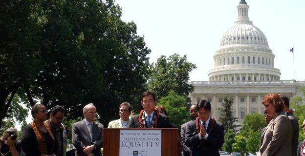 Blayne Higa of Hawaii leads the Buddhist invocation Tuesday at a rally of religious leaders for gay equality legislation.