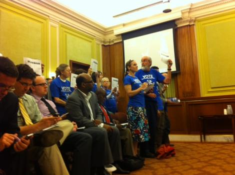 Advocates silently protest as the D.C. Council votes to reject the income tax proposal Wednesday.