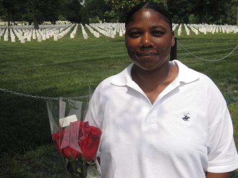 Towanna Towns visited the grave of her uncle at Arlington National Cemetery on Friday. She says Monday's crowds can ruin the sense of peace and quiet that she likes.