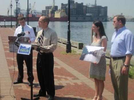 Tommy Landers of Environment Maryland speaks at the release of a report on the state's efforts regarding climate change at Fells Point in Baltimore.