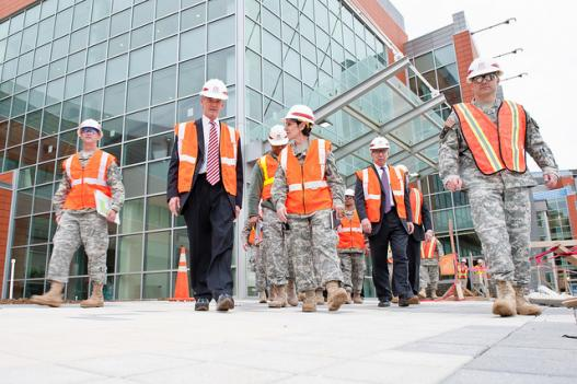 Secretary of the Army John McHugh (center left) walks out of the Fort Belvoir Community Hospital Meadows Pavilion along with Col. Susan Annicelli (center right), commander of DeWitt Army Community Hospital, and other U.S. Army and Defense Department officials, April 13, 2011.