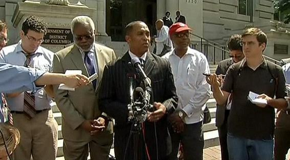 D.C. Council member Harry Thomas Jr., shown here at a press conference outside city hall in June, settled the lawsuit that claimed he misused $300,000 of taxpayer funds. Now some of his colleagues are calling for him to resign.