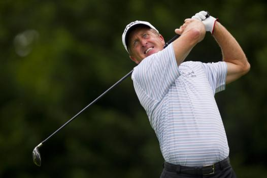 Fred Funk hits his tee shot on the 5th hole during the first round at the U.S. Open on Thursday.