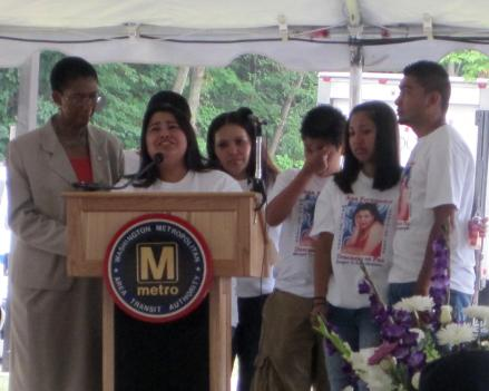 Evelyn Fernandez, the daughter of crash victim Ana Fernandez, breaks down as she speaks at a memorial ceremony.
