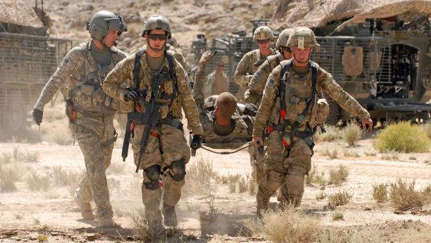 U.S. Army private first class is evacuated after being injured by a roadside bomb in the Kandahar province of Afghanistan on June 17.