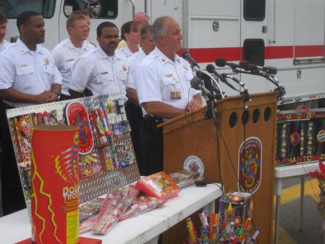 Montgomery County Fire Chief Richard Bowers speaks behind a collection of illegal fireworks.