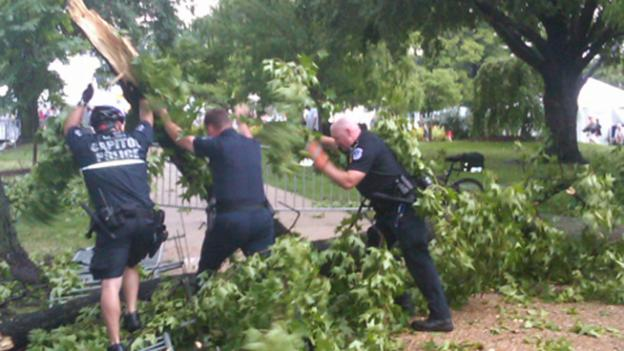 Capitol Police work to clear parts of the National Mall after the strong thunderstorms that tore through the D.C. region yesterday.