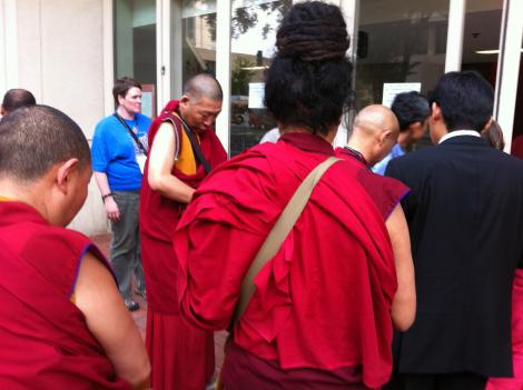 Hundreds of people, many of them in traditional red robes, arrived at Verizon Center for the Kalachakra event hosted by the Dalai Lama in D.C. July 6.