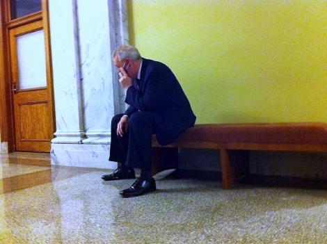 Ward 6 Council member Tommy Wells talks on his cell phone outside the D.C. Council room after Council Chair Kwame Brown announced he'd be shifting the leadership of the council's committees.