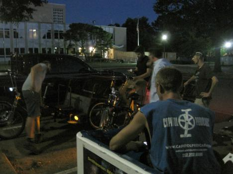 Pedicab drivers held an impromptu vigil in front of  U.S. Park Police headquarters after they say one of their fellow drivers was shocked with a Taser while picking up passengers last week.