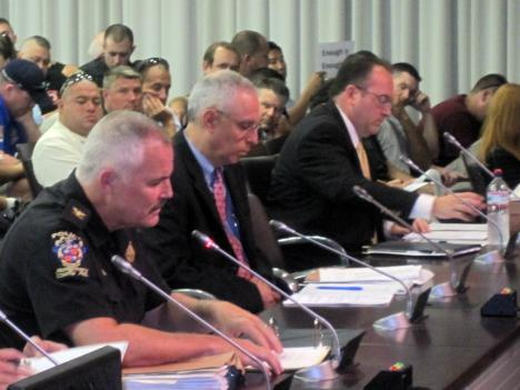 Police Chief Thomas Manger, left, speaks to county council.  At the far right at the table is Marc Zifcak, president of the Fraternal Order of Police Lodge 35.