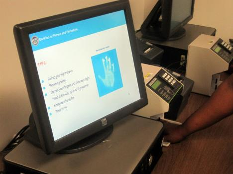 The hand reader, at right, on Maryland's new digital check-in stations for people on the states parole and probation rolls, makes sure the offender checking in is actually that person.