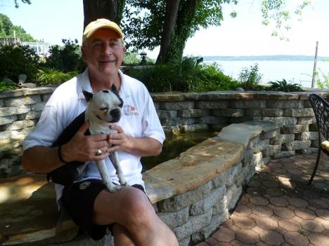 Peter Weyland and his dog, Patches, relax at their waterfront home in Mason Neck, Virginia.