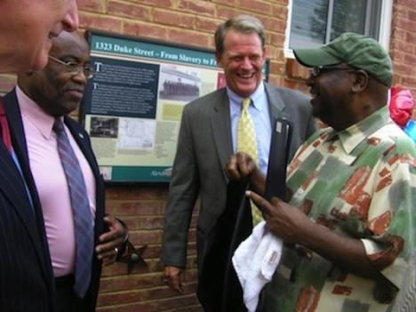 Alexandria Mayor Bill Euille, left, and Vice Mayor Kerry Donley share a laugh with the Rev. Earl Lee, pastor of Shiloh Baptist Church, during the unveiling of a new historical marker at Beasley Square.