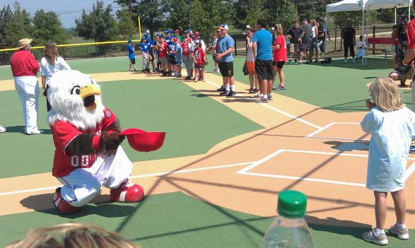 Nats' mascot Screech plays with the athletes at the opening of Miracle Field in Germantown, Md. Aug. 1.