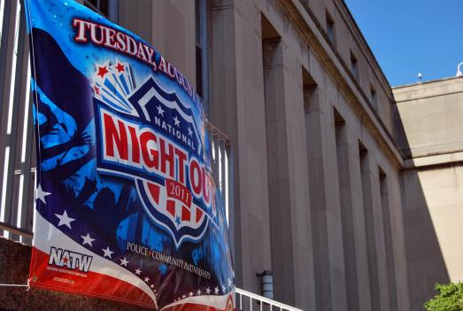 The Metropolitan Police Department is marking National Night Out with this banner on its headquarters in downtown D.C.